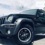 Как поменять уплотнение оси на 2003 Jeep Liberty