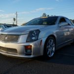 Как установить дополнительный стереопорт в Cadillac CTS 2006 года
