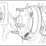 Как выполнить регулировку стояночного тормоза в Chevy Silverado