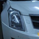 Как поменять лампу фар в Cadillac SRX