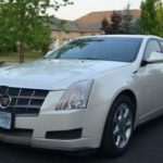 Как устранить неполадки застрявшего компакт-диска в Cadillac CTS