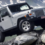 Как заменить выпускной коллектор на Jeep Wrangler 1997 года
